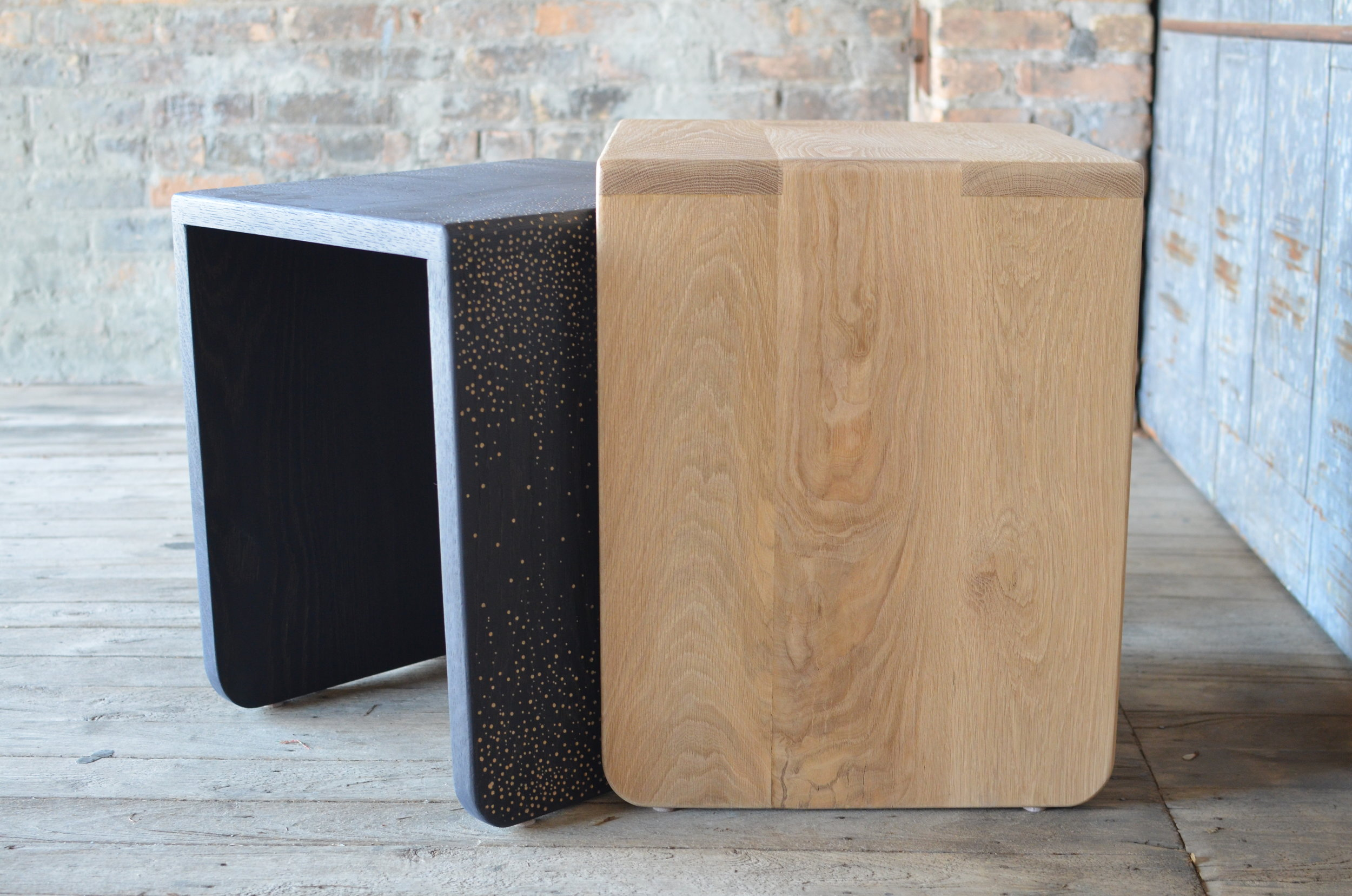 SPECKLE NESTING - Solid white oak nesting tables with a hand carved speckled dot pattern. Each set comes with one natural and one ebonized oak table. The ebonized table features the hand-carved texture.Contact us for price and lead time.