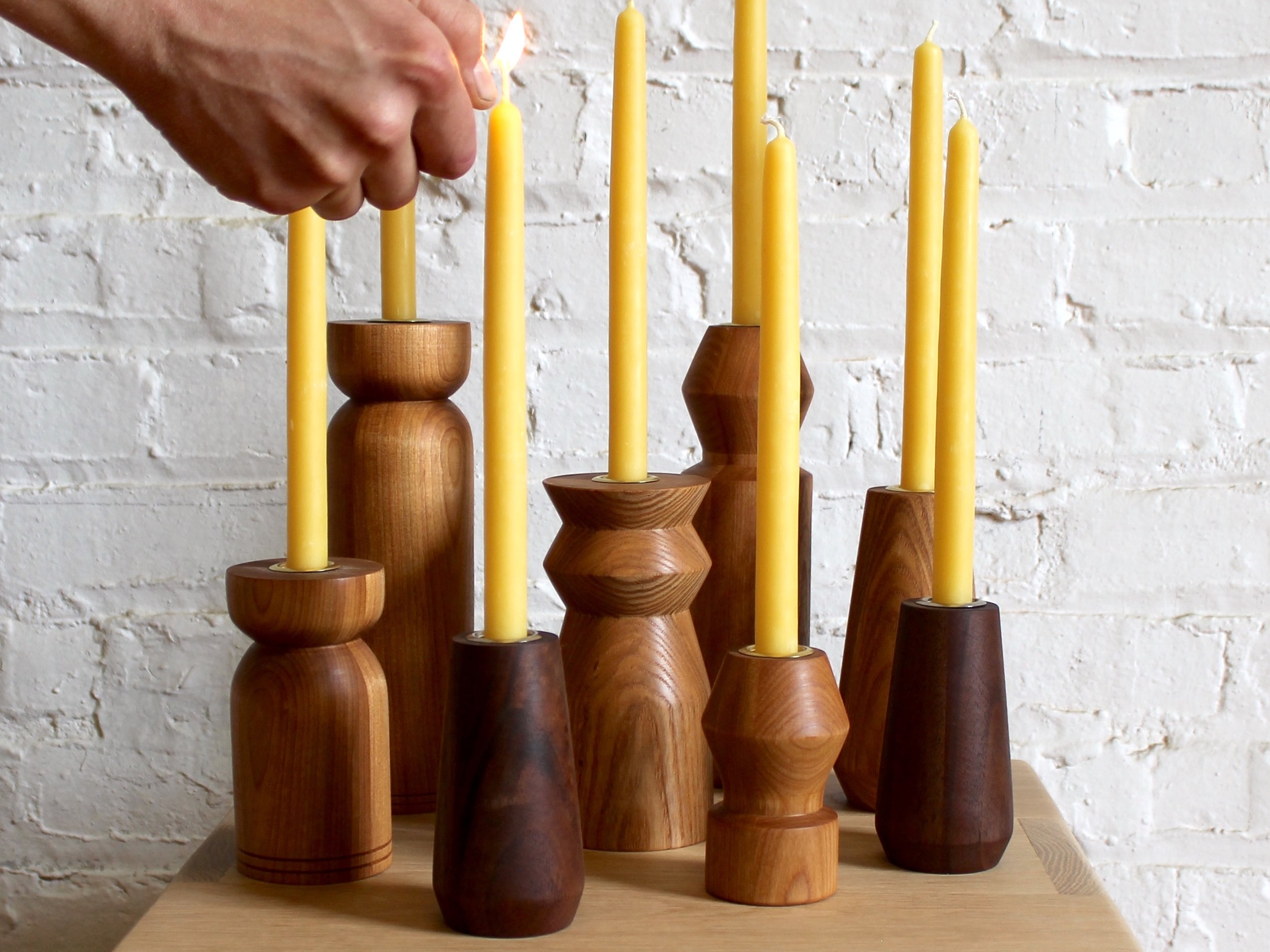 CANDLE HOLDERS - These candle holders were hand made on the lathe out of a variety of woods such as walnut, oak and cherry. They serve as the perfect accent piece, whether that be on your fireplace mantel or dining room table. Mix and match different shapes and woods to change up your decor.Each candle holder fits standard taper candles