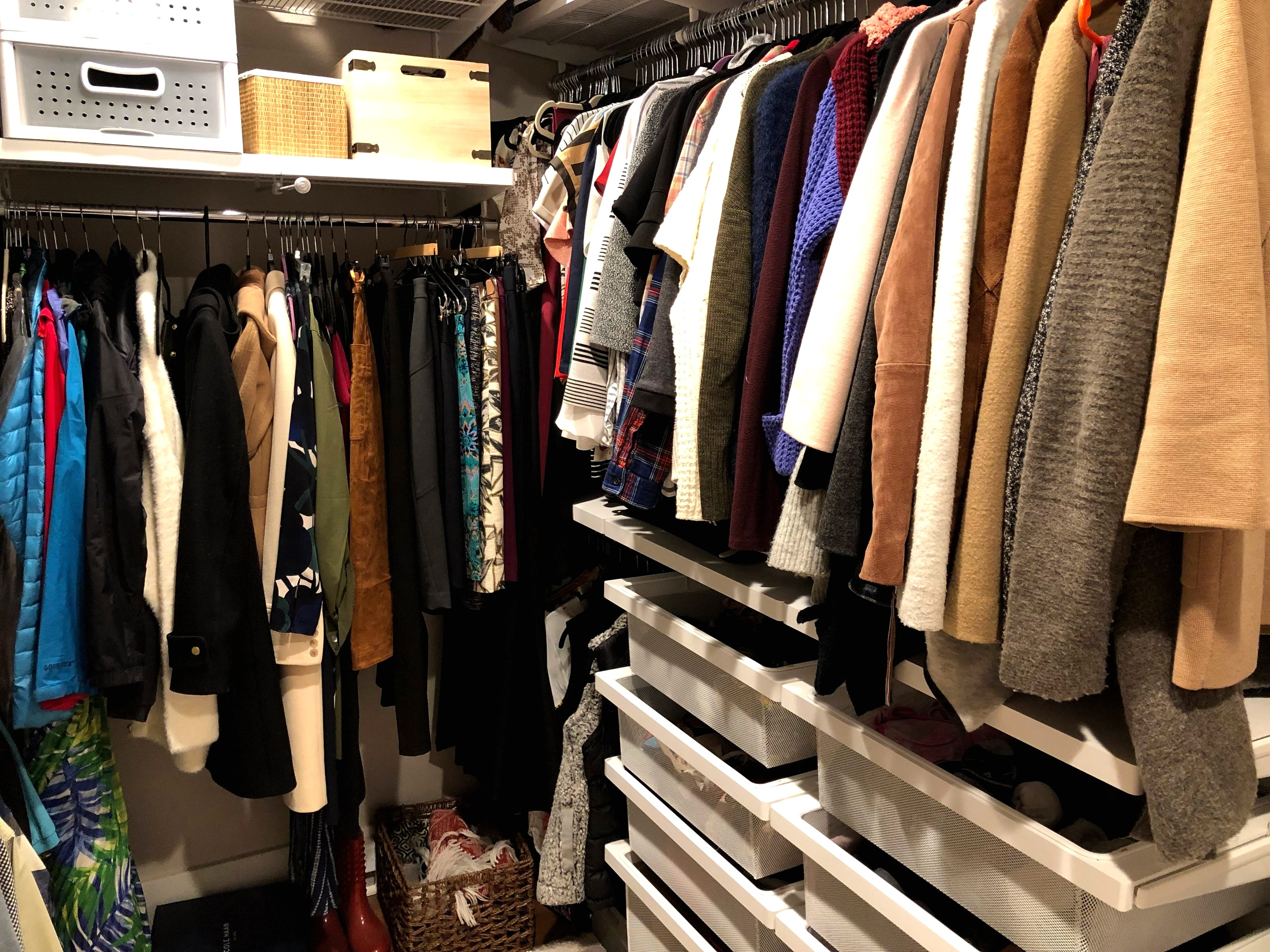 The closet of someone who does not need any more clothes.