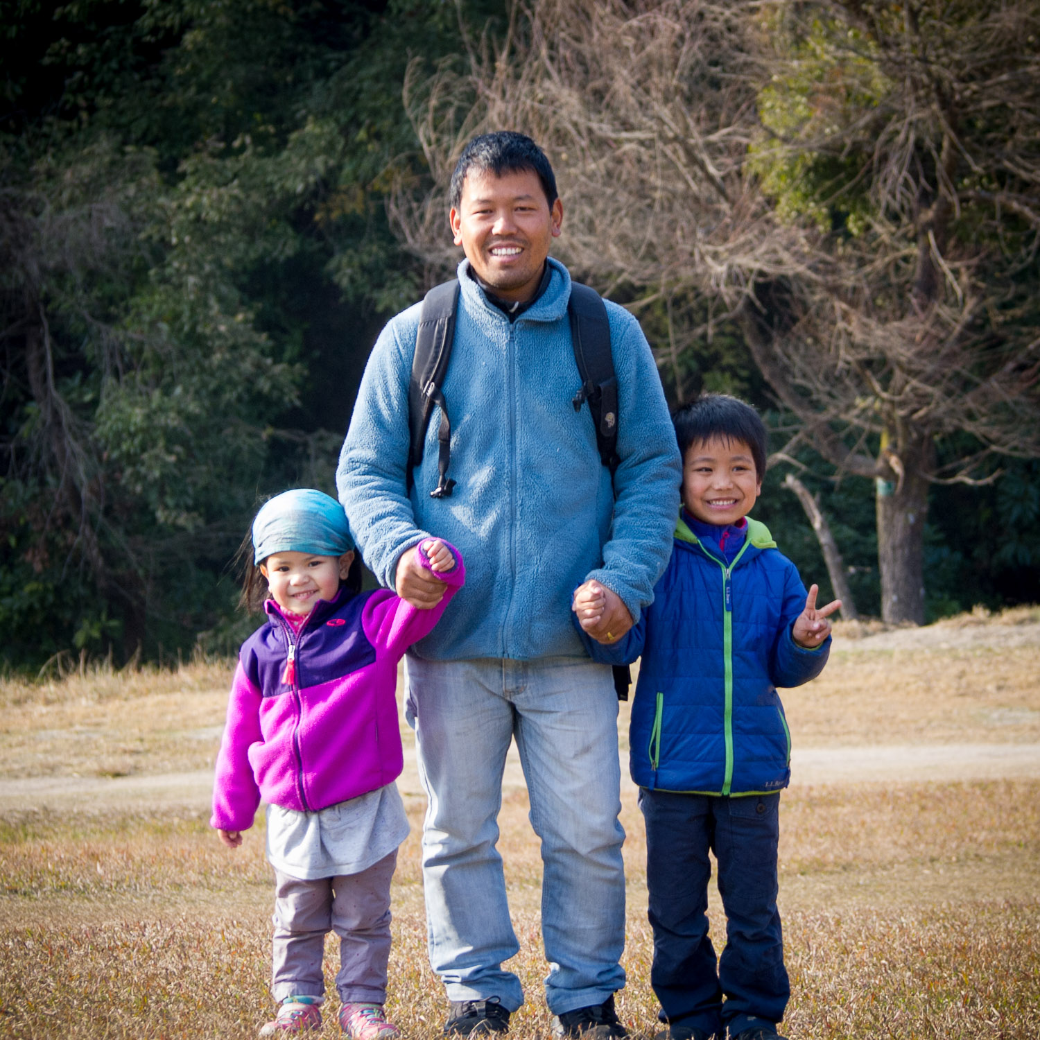 Karma Sherpa with his two young children.
