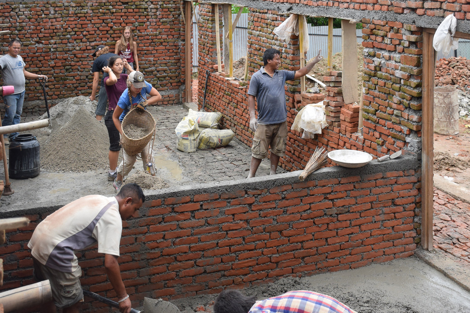Volunteer students are helping to build a home for girls, working together with the local community.