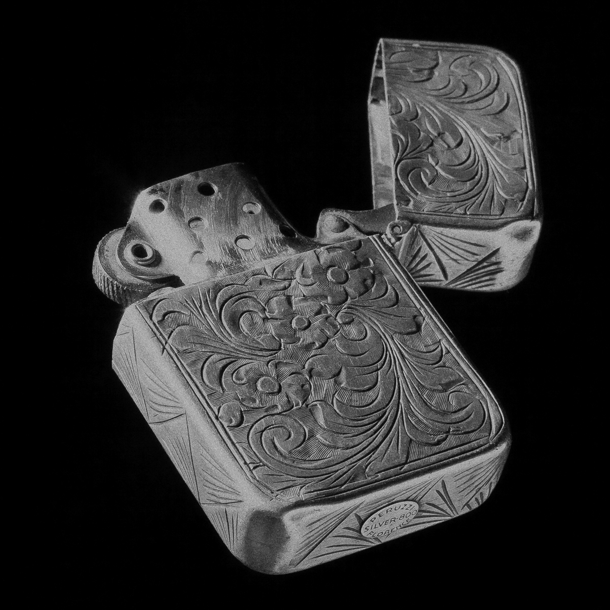 HAND CARVED LIGHTER.jpg