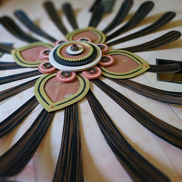 Center mandala complete. Steamed and bent zebra wood, rice paper insets, antique bracelet, and brooch.
