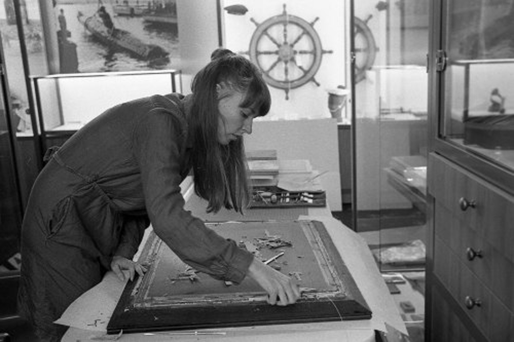 Meghan Ellis removing the photograph described above from its frame / Photograph by Dominic King