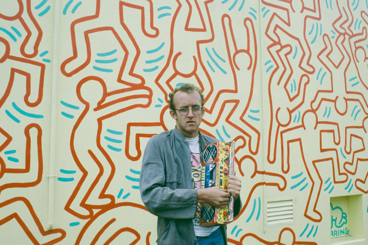 Keith Haring in front of his Collingwood mural, 1984 / Photograph by Polly Borland (via  ACCA )