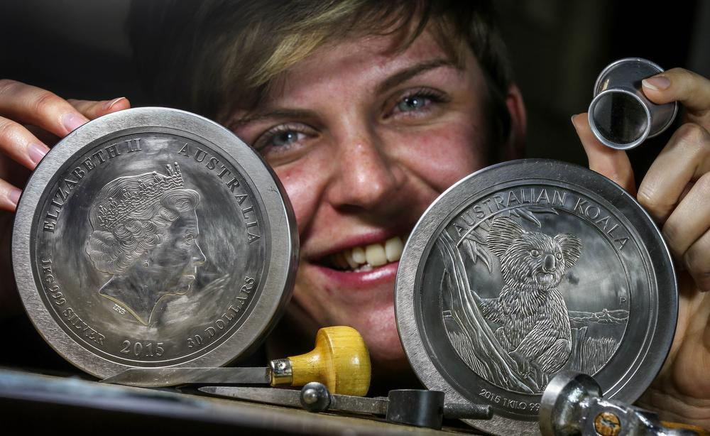 Claire Rowson with master reduction punches used to produce silver coin / Photograph by Nic Ellis,   The West Australian