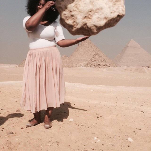 The weight of the world at the Pyramids of Giza, Egypt.