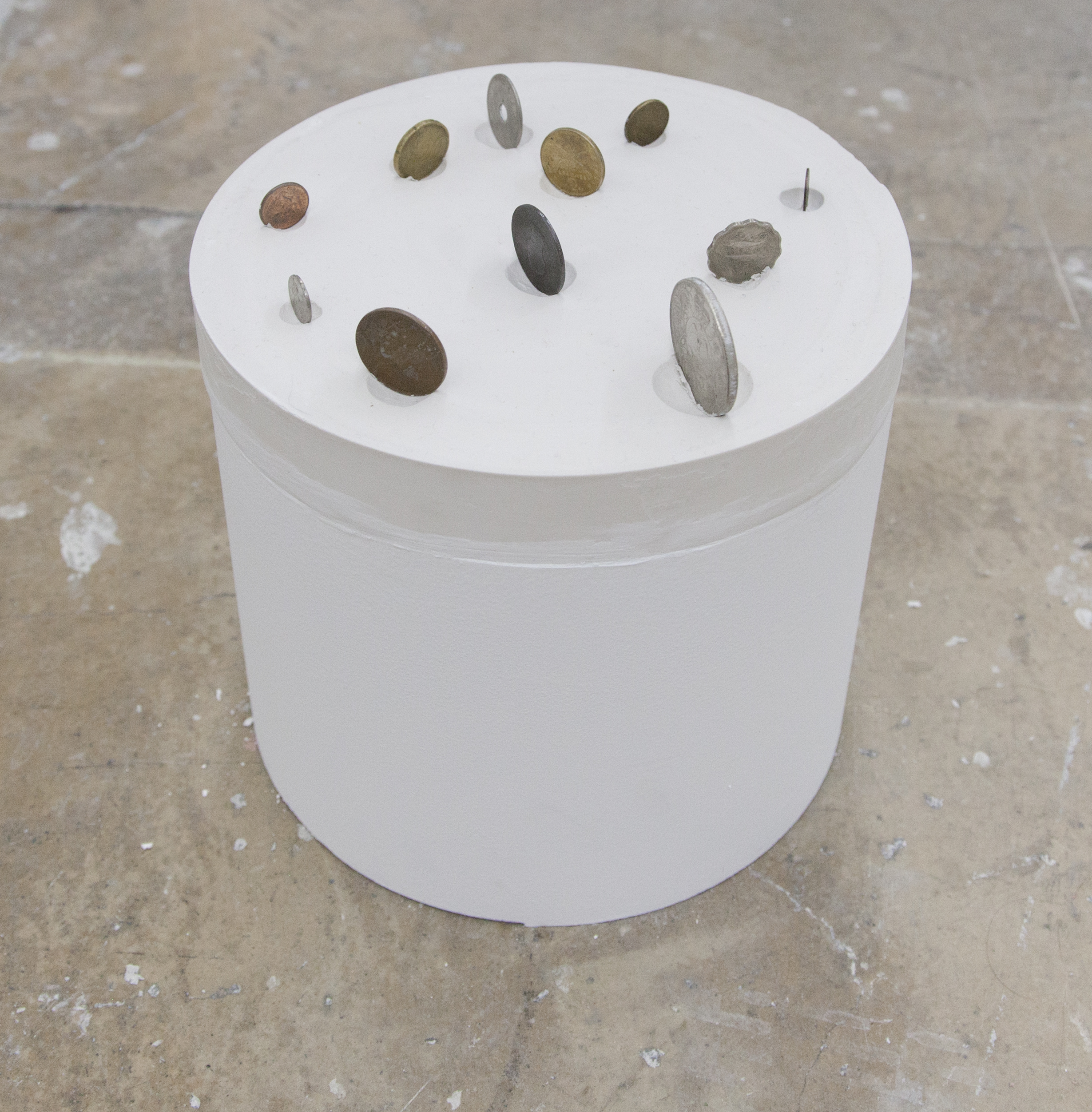 Semazen, friction with the Earth's surface , 2018. Plastic, Plaster, Paint, Coins.