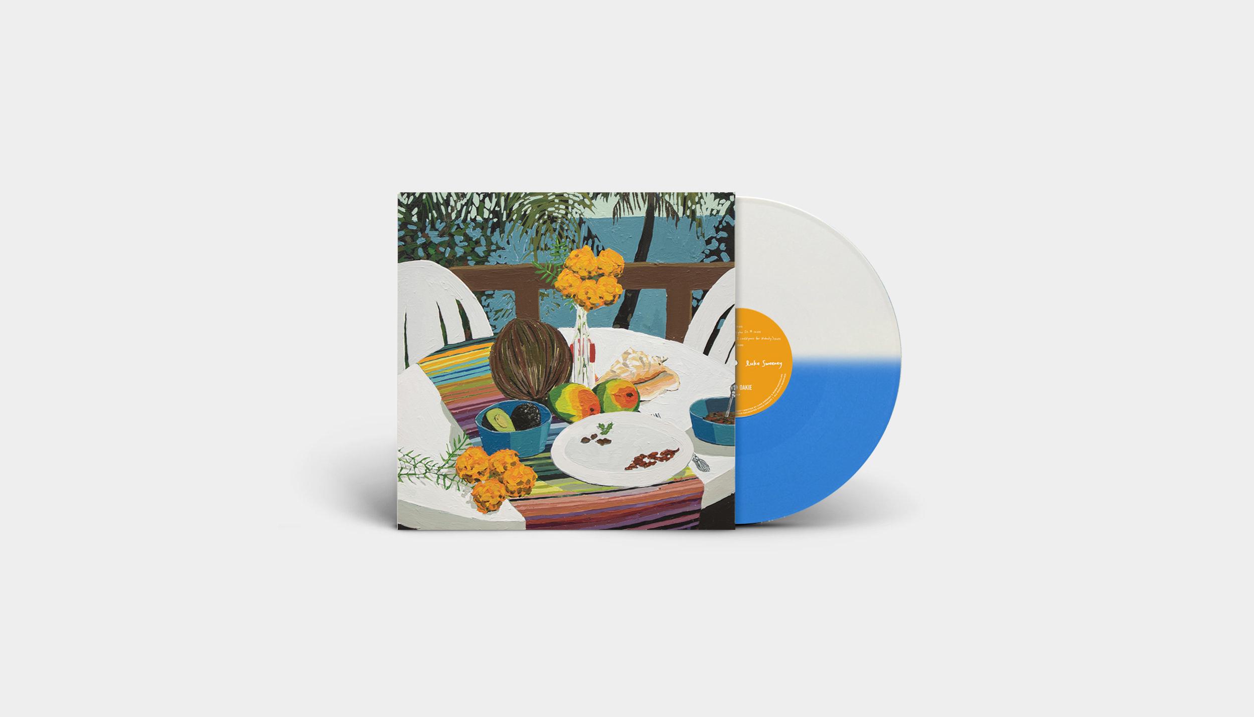 DE019LP-peacemeal-album-mockup-wide-BlueWhiteSplit-Vinyl.jpg