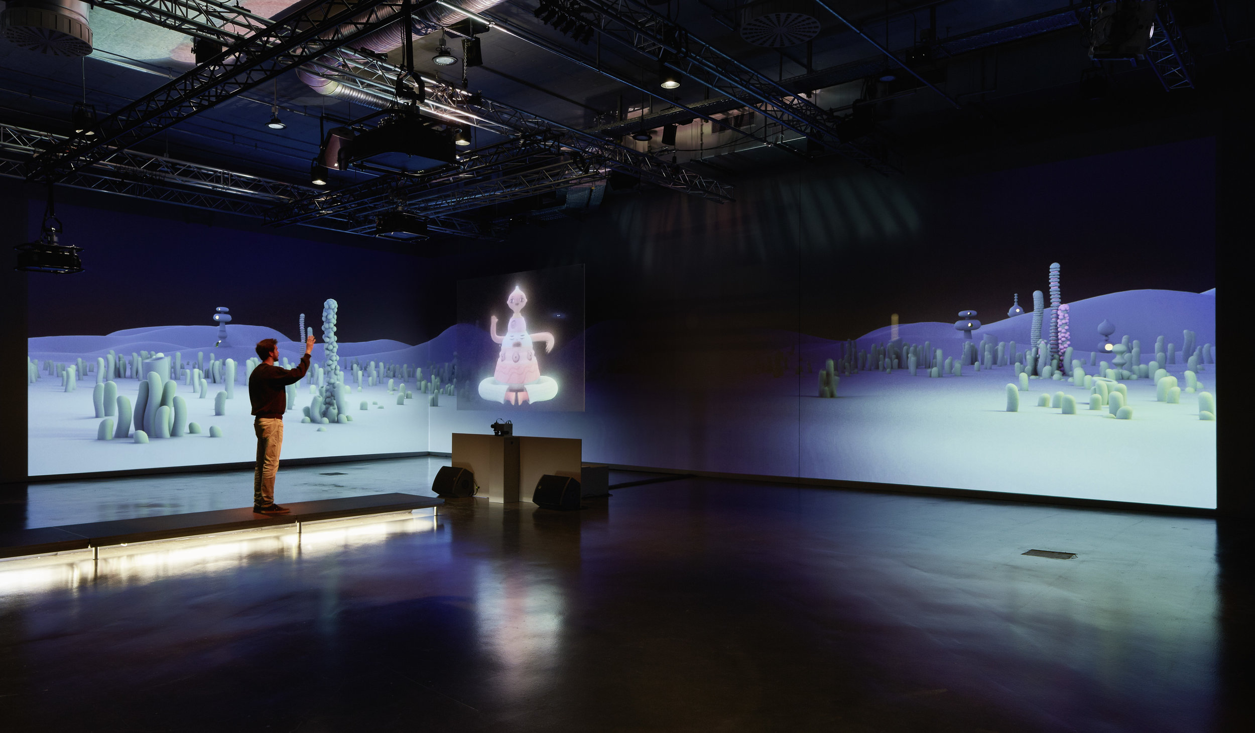 Visitors could approach the hologram one at a time on a elevated catwalk. Sensors detected proximity and the frequency of a user's movement. Using this data, the projected character would grow, retract and engage in different behaviours.