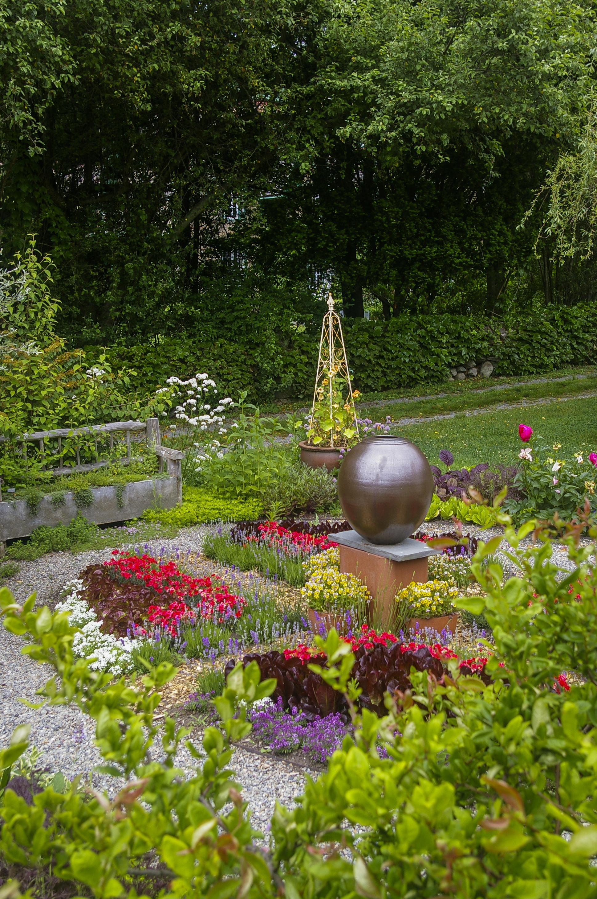 Glazed globe in flower garden