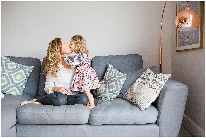 toddler kissing mum