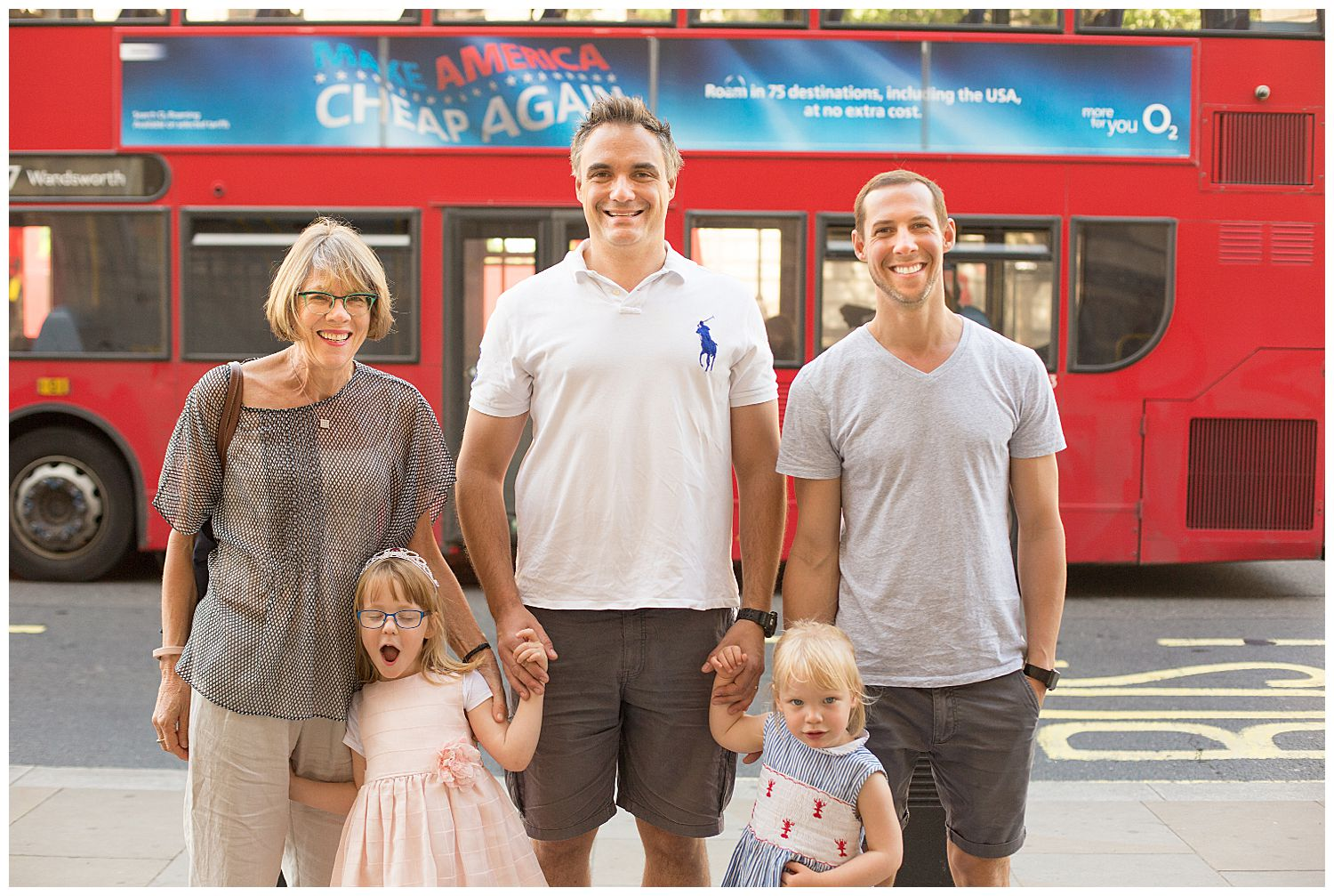 family in front of London bus