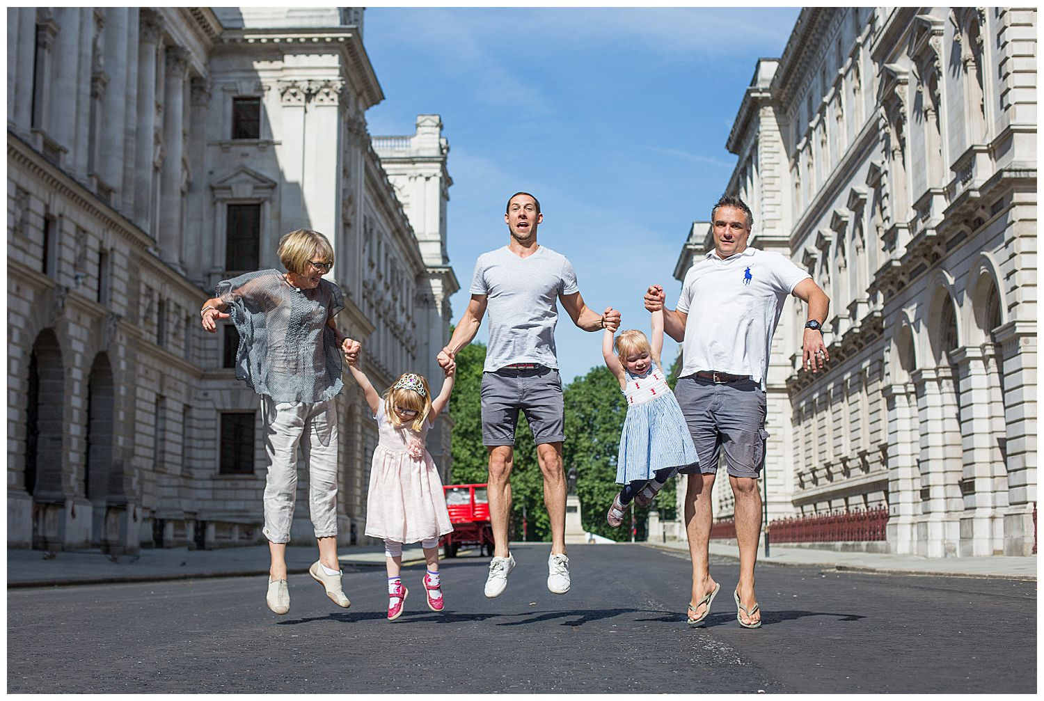 family jumping in London Westminster