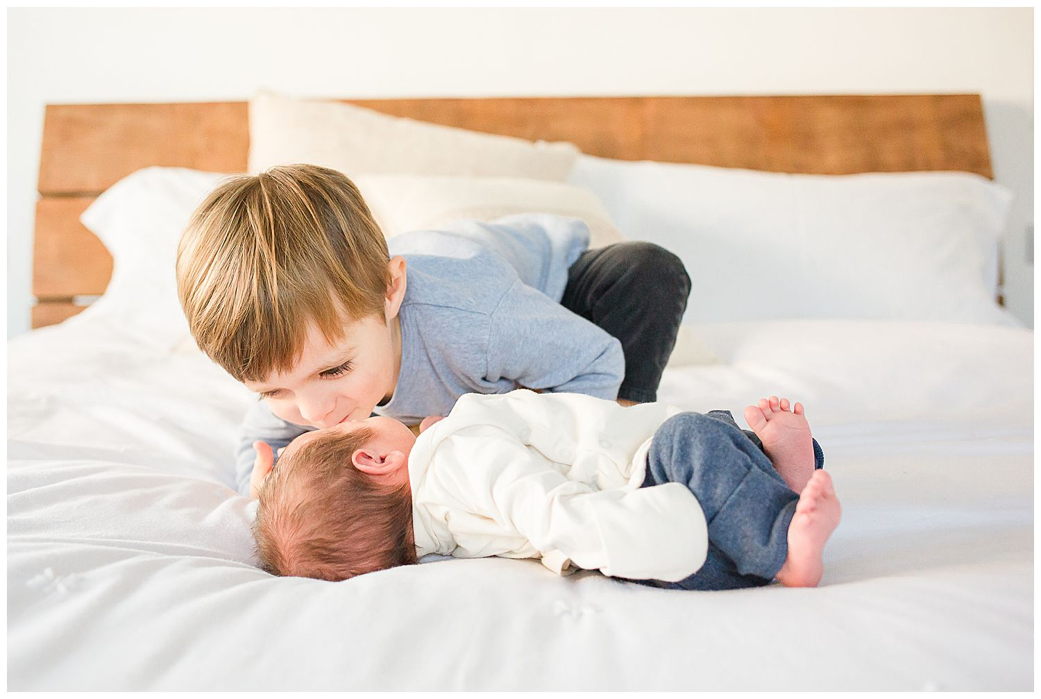 3 year old kissing baby brother