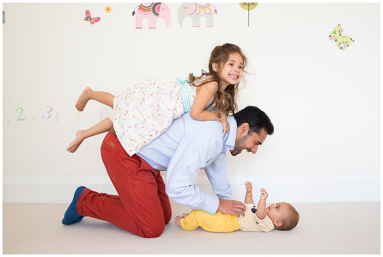 4 year old on dad's back & baby on floor
