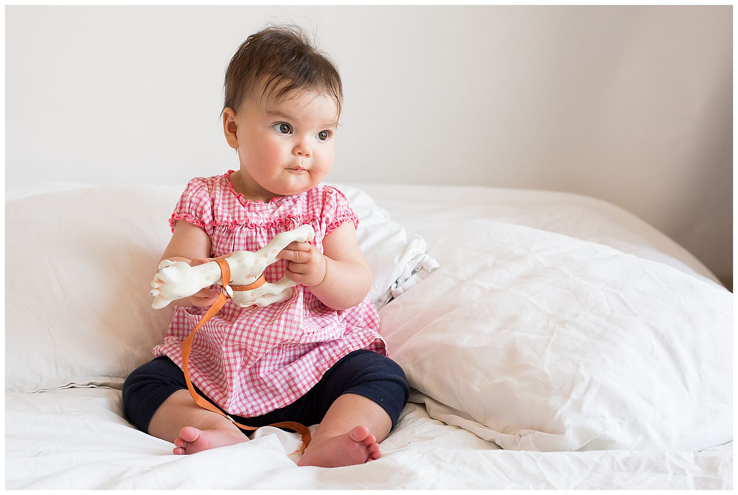 7 month old holding teether