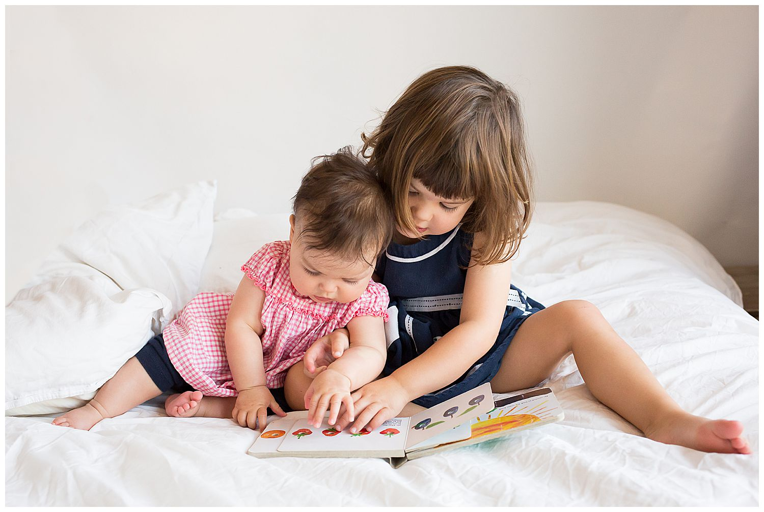 two sisters reading the hungry caterpillar