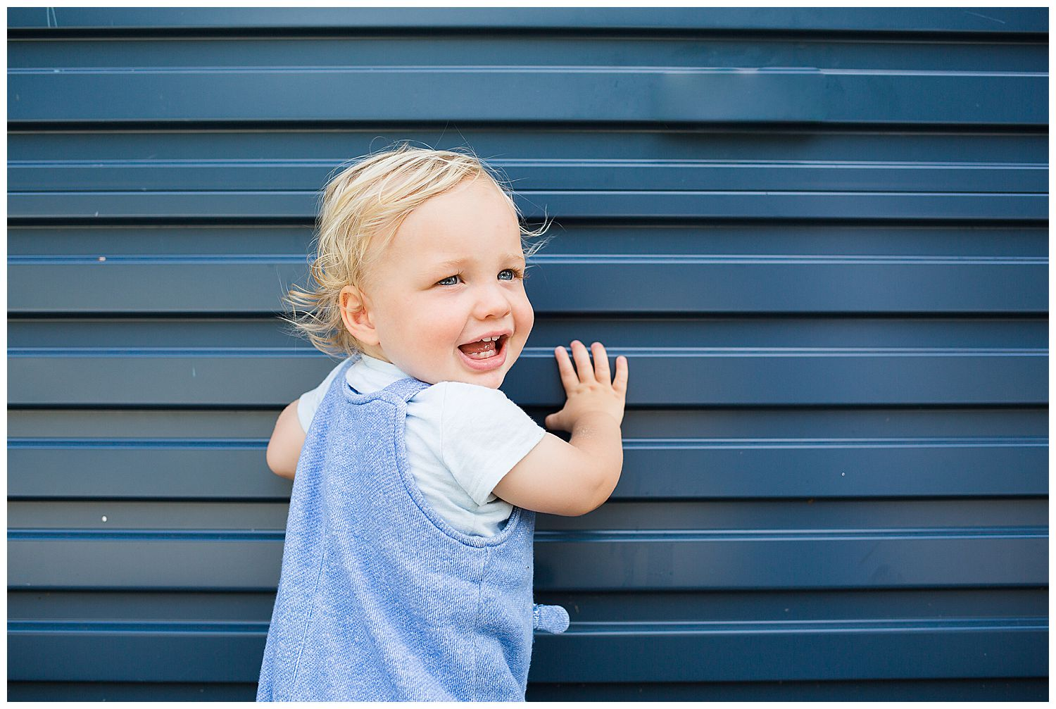 baby and blue wall