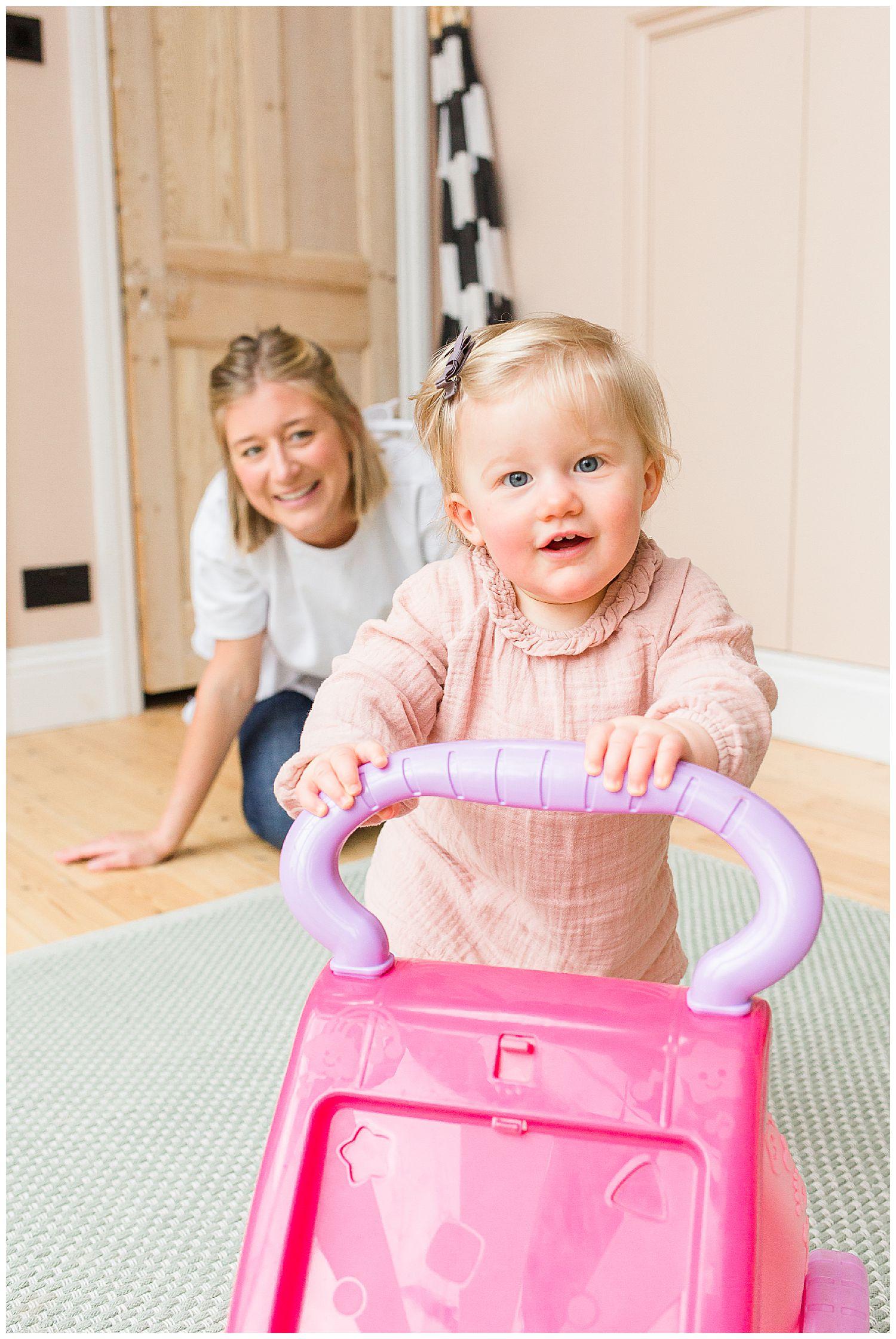 baby pushing walker