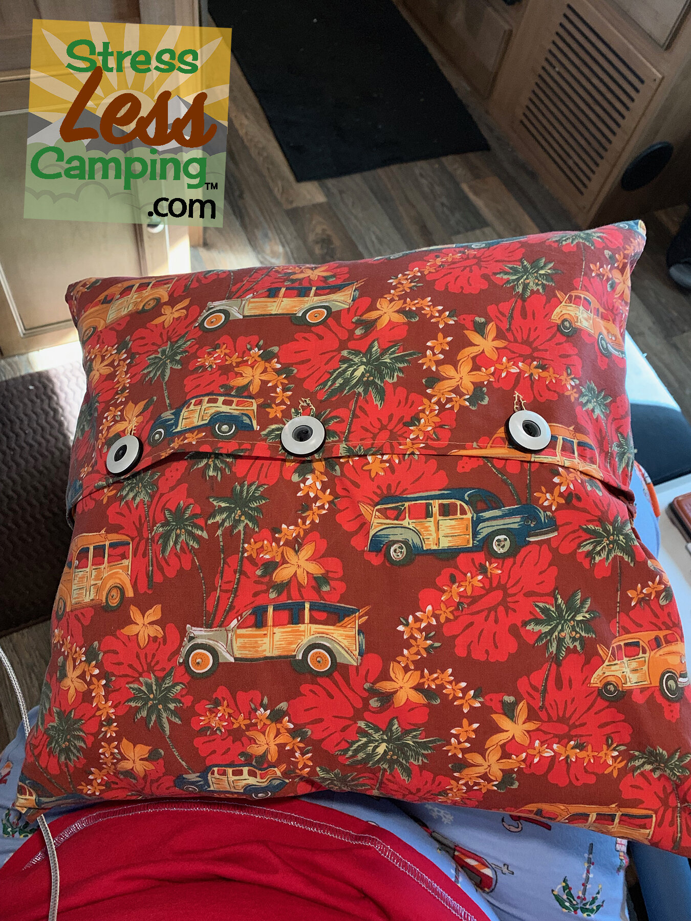 I simply recovered the pillows with woody-themed fabric and even used hubcap-themed buttons!