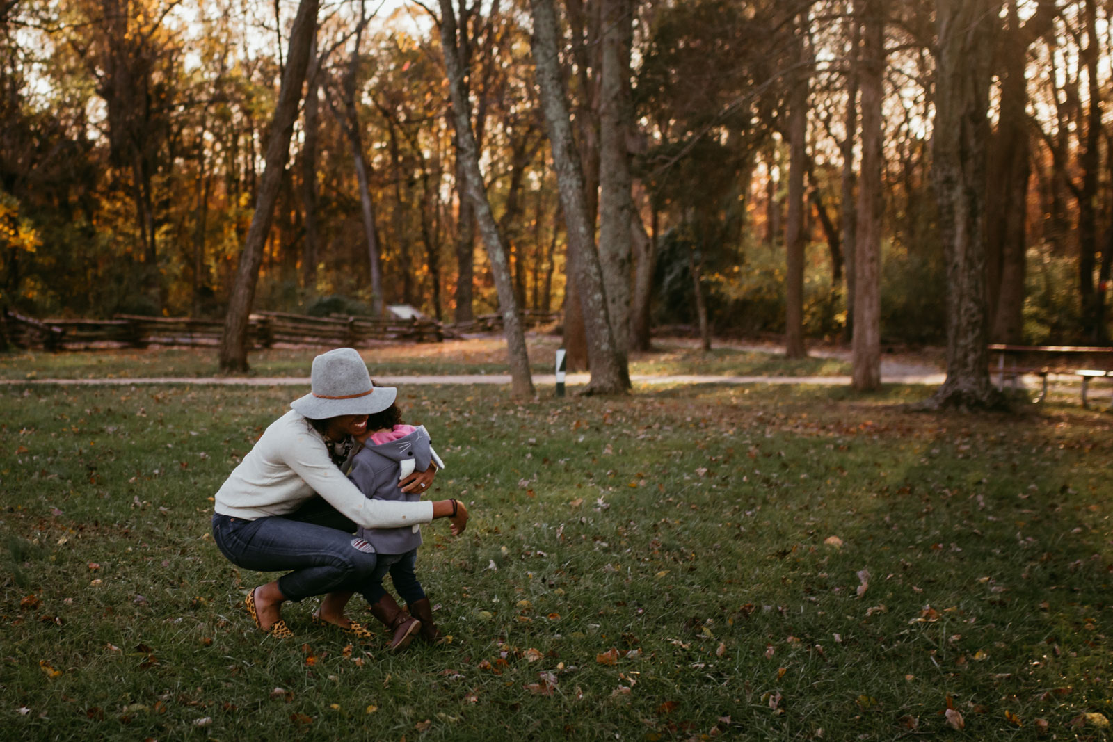 Girl runs to her mom and gives her a big hug  at Ellanor C. Lawrence Park in Chantilly, Virginia
