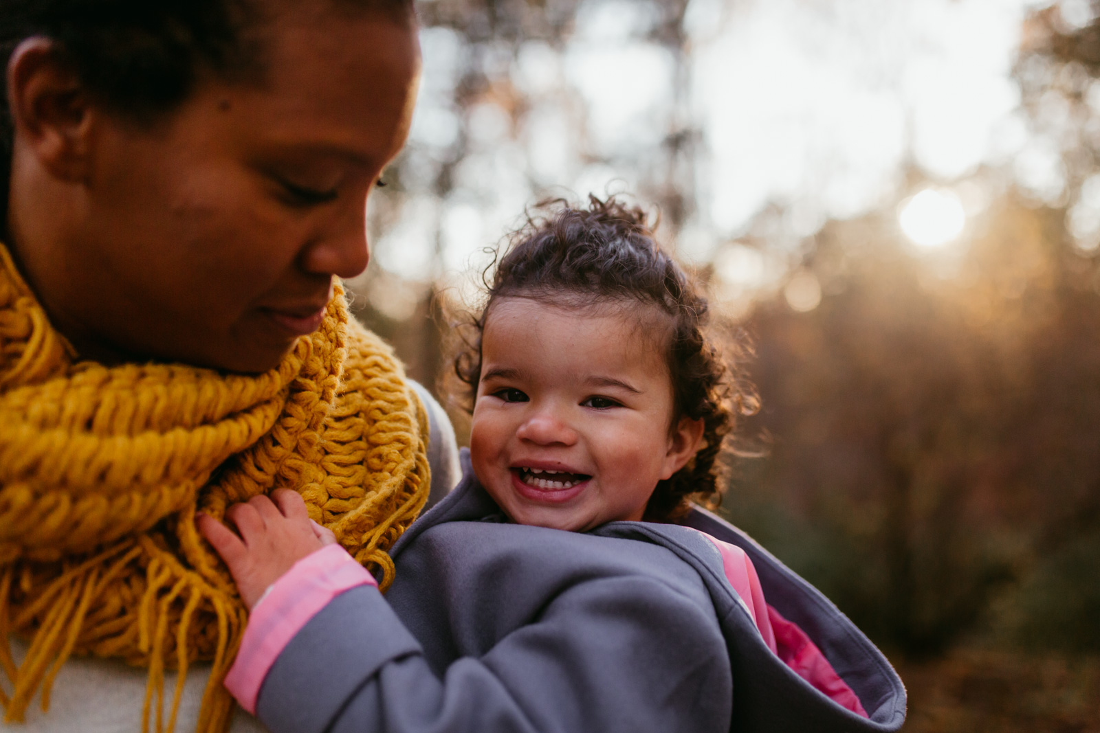 Portrait of a toddler being held by her mom at sunset  at Ellanor C. Lawrence Park in Chantilly, Virginia