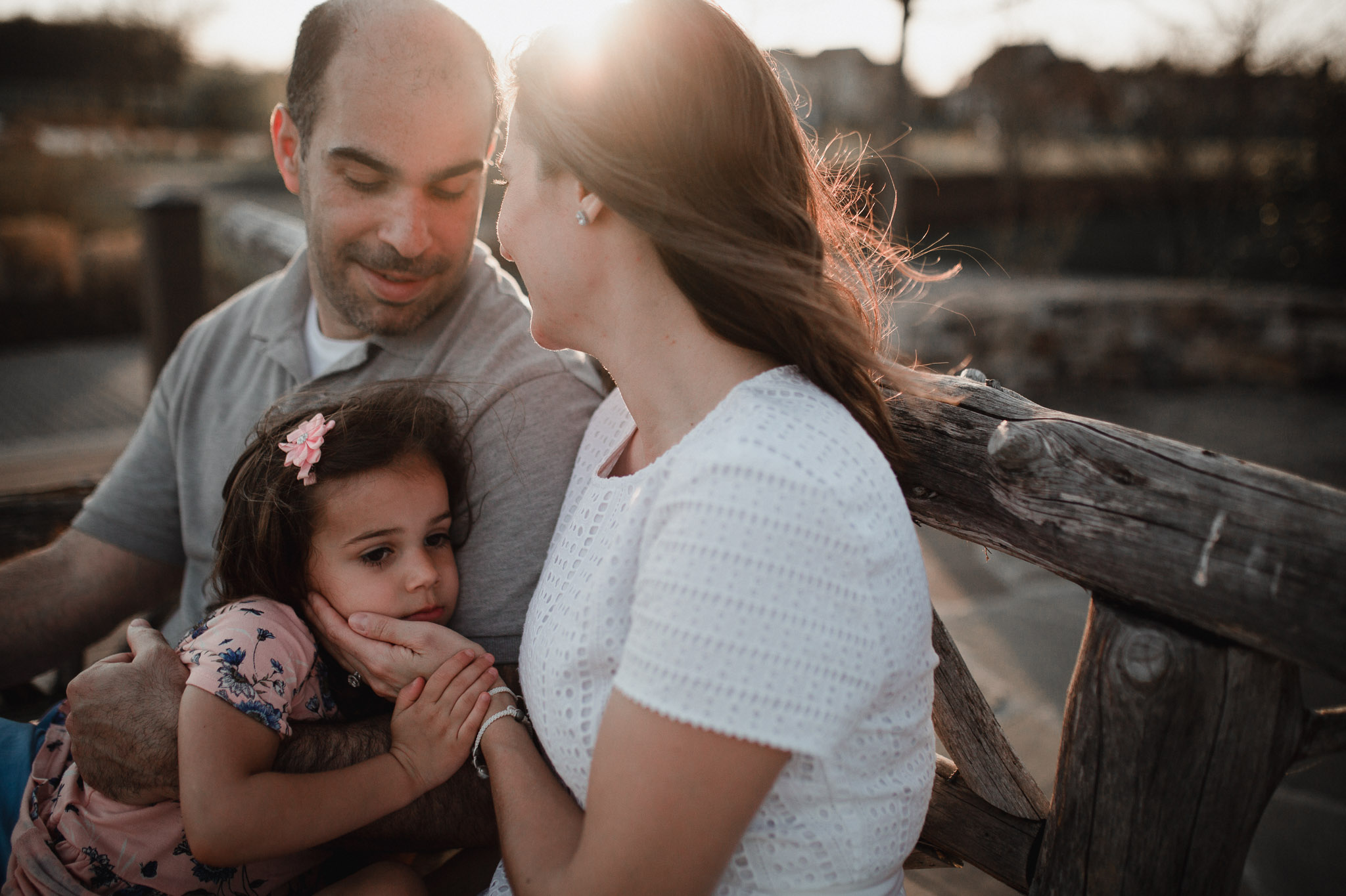 family sits together at sunset at Willowsford Boat House Aldie, VA