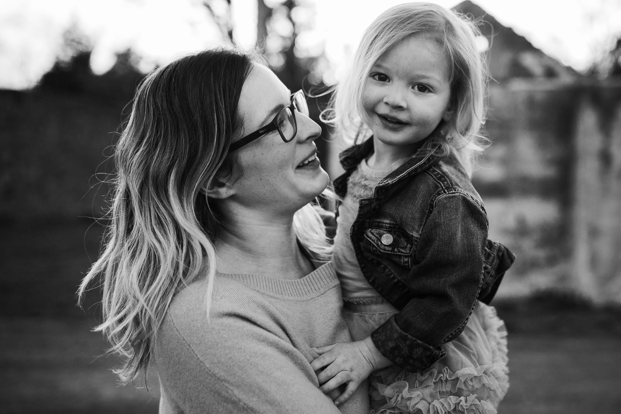 Black and white portrait of mom and her toddler daughter at Red Rock Overlook in Leesburg, VA