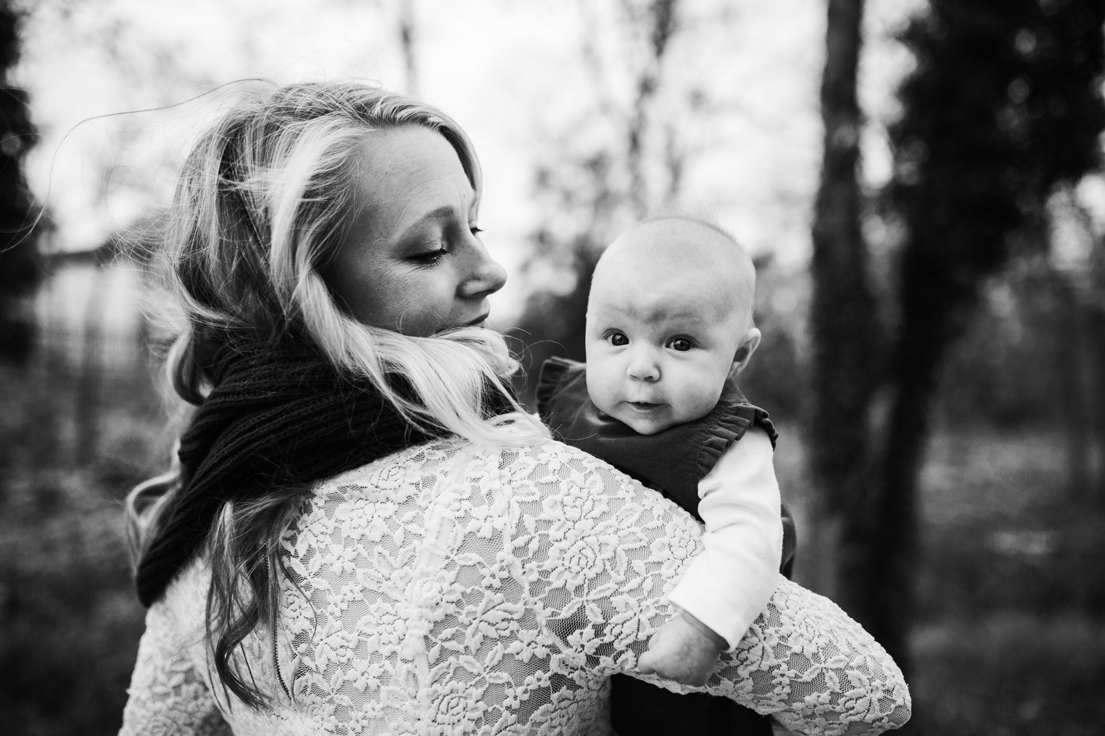 Black and white; mom holding infant at The Barn at One Loudoun, Ashburn, Virginia