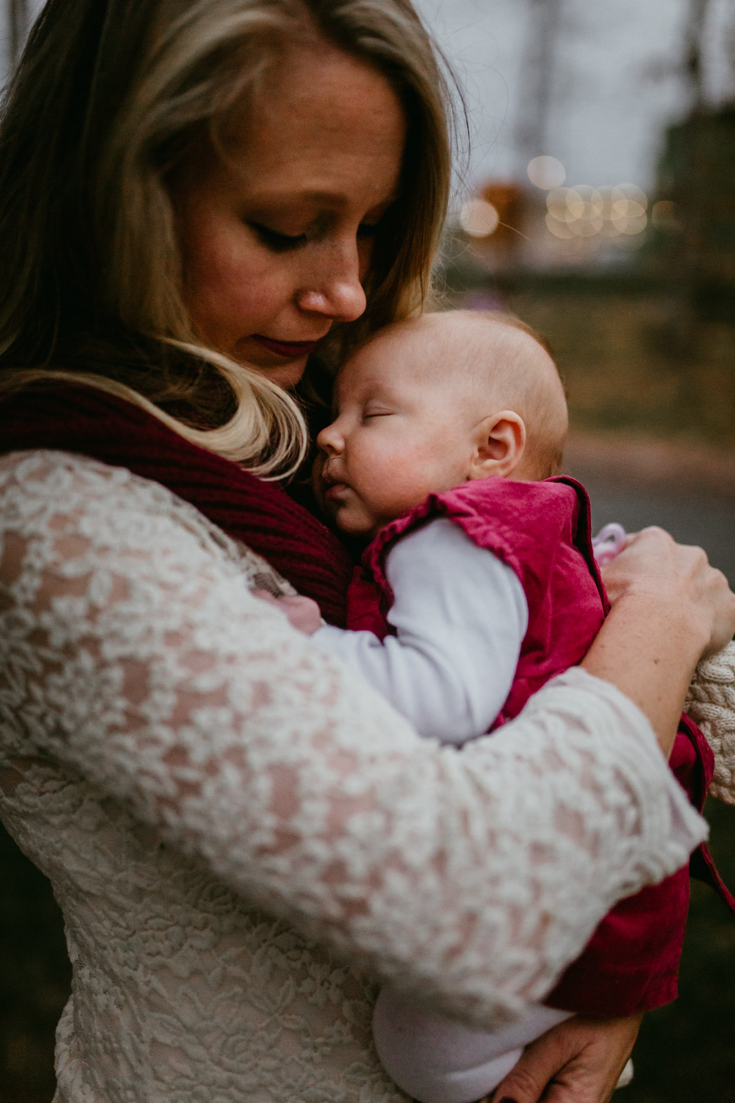 Baby girl asleep in her mother's arms at The Barn at One Loudoun, Ashburn, Virginia
