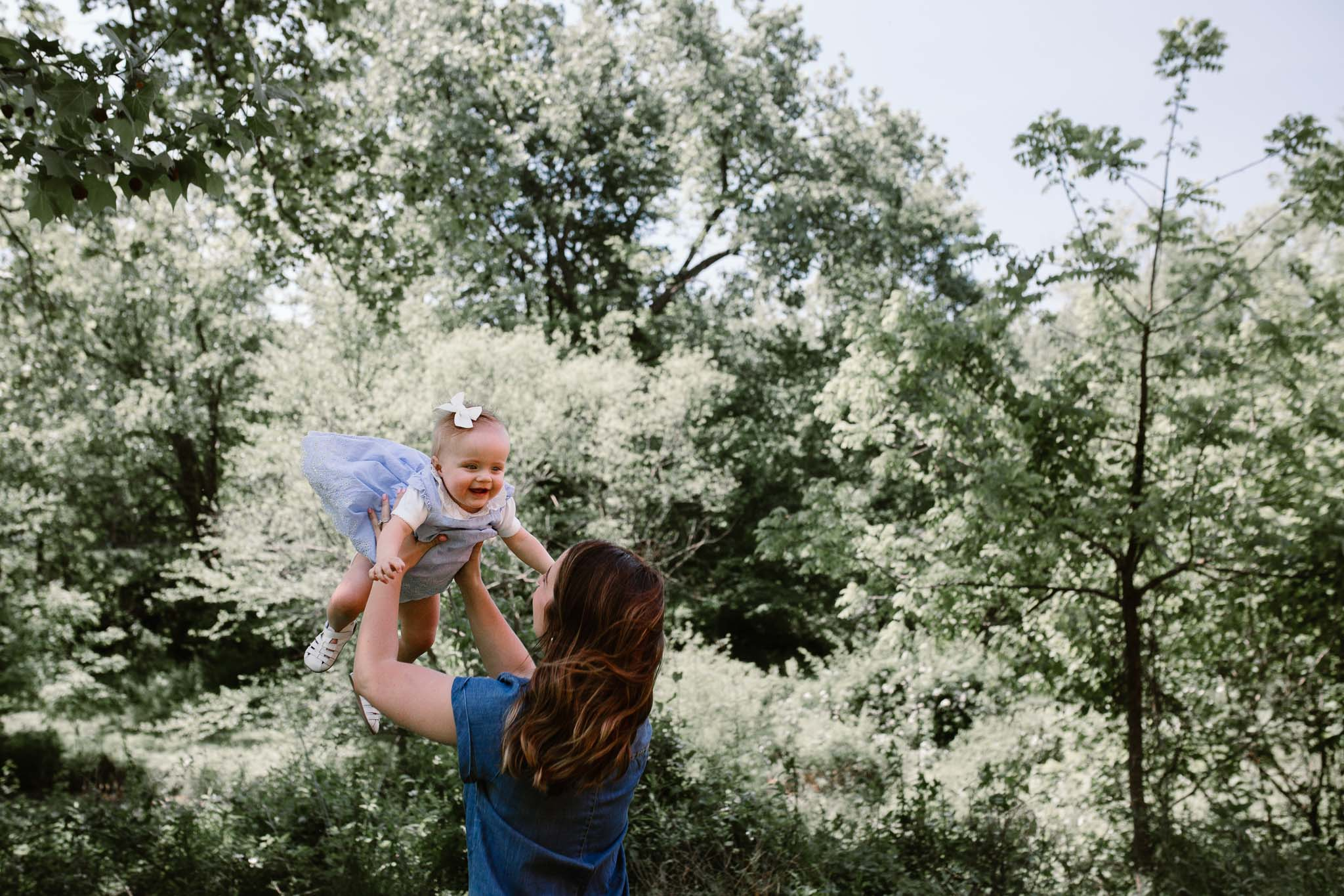 mom lifts daughter family photography Colvin Run Mill Great Falls Virginia