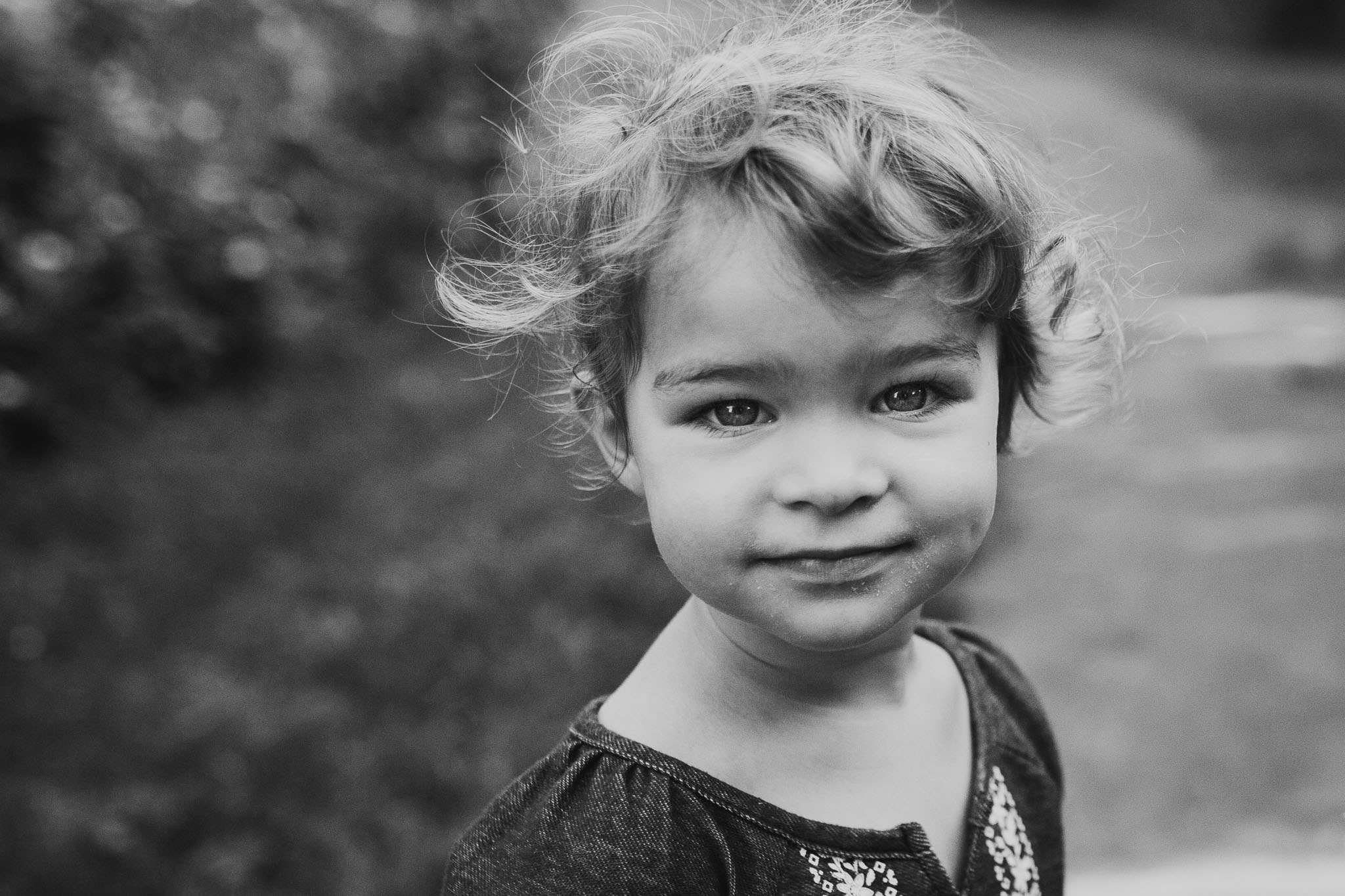 black and white portrait of a toddler girl at Bles Park in Ashburn, Virginia
