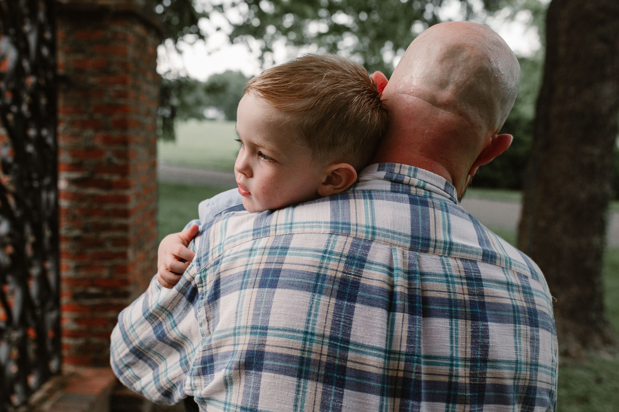father gives his son a big hug at Morven Park in Leesburg, Virginia