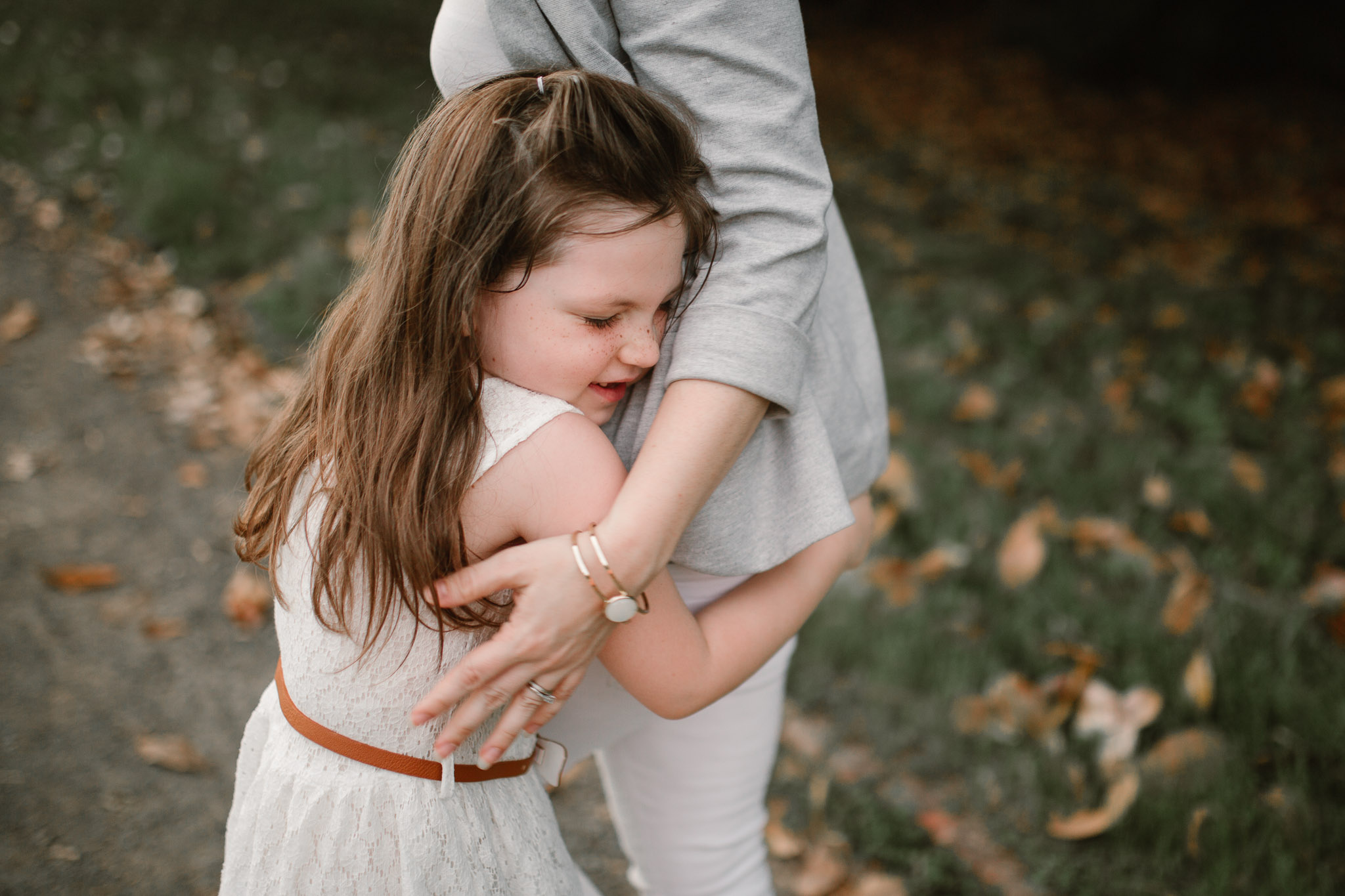Young girl gives her mom a big hug at Morven Park in Leesburg, Virginia