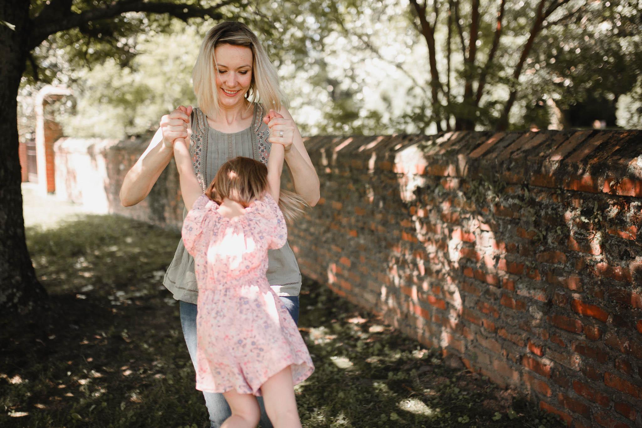 Mom twirling her daughter in a circle at Morven Park in Leesburg, Virginia