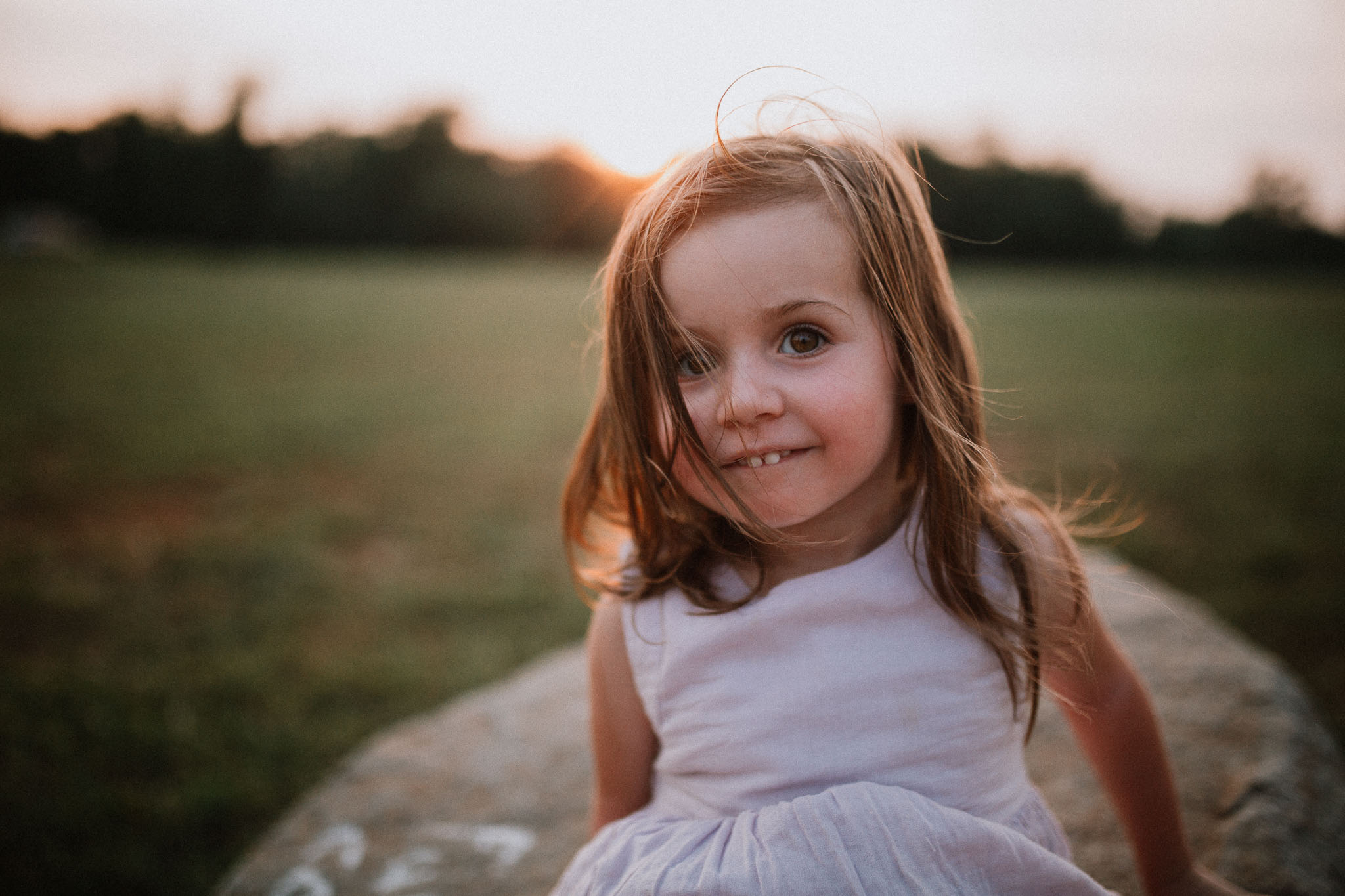 Portrait of a girl wearing a purple dress at sunset in Ashburn, Virginia