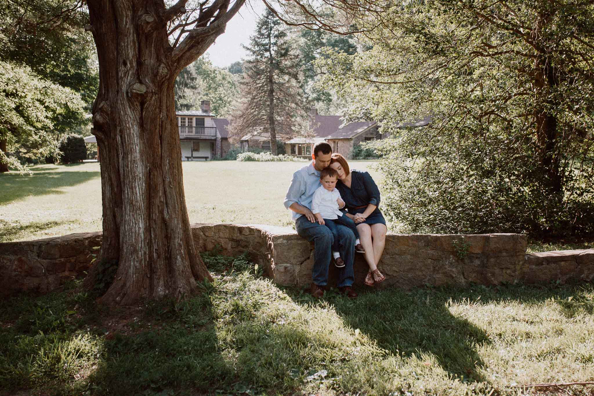 Family of three sit together at Cabell's Mill in Chantilly, Virginia