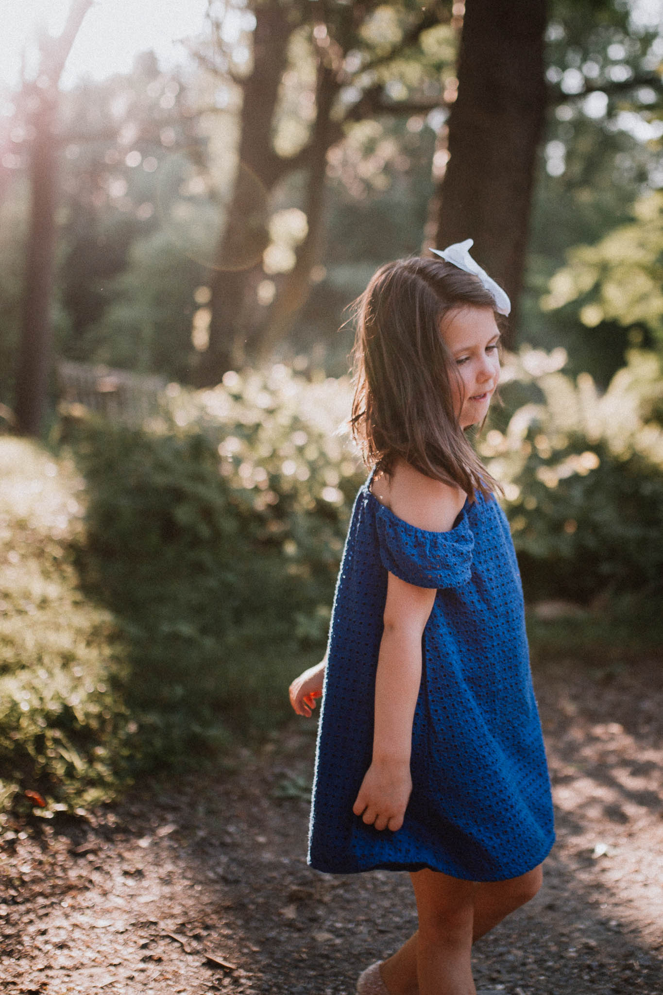 Young girl in a blue twirlilng at Colvin Run Mill in Great Falls
