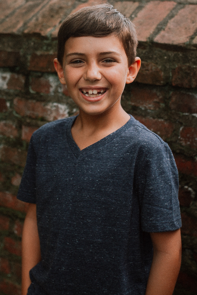 Child Boy portrait brick wall lifestyle family photography Marti Austin Photography Morven Park Leesburg Virginia