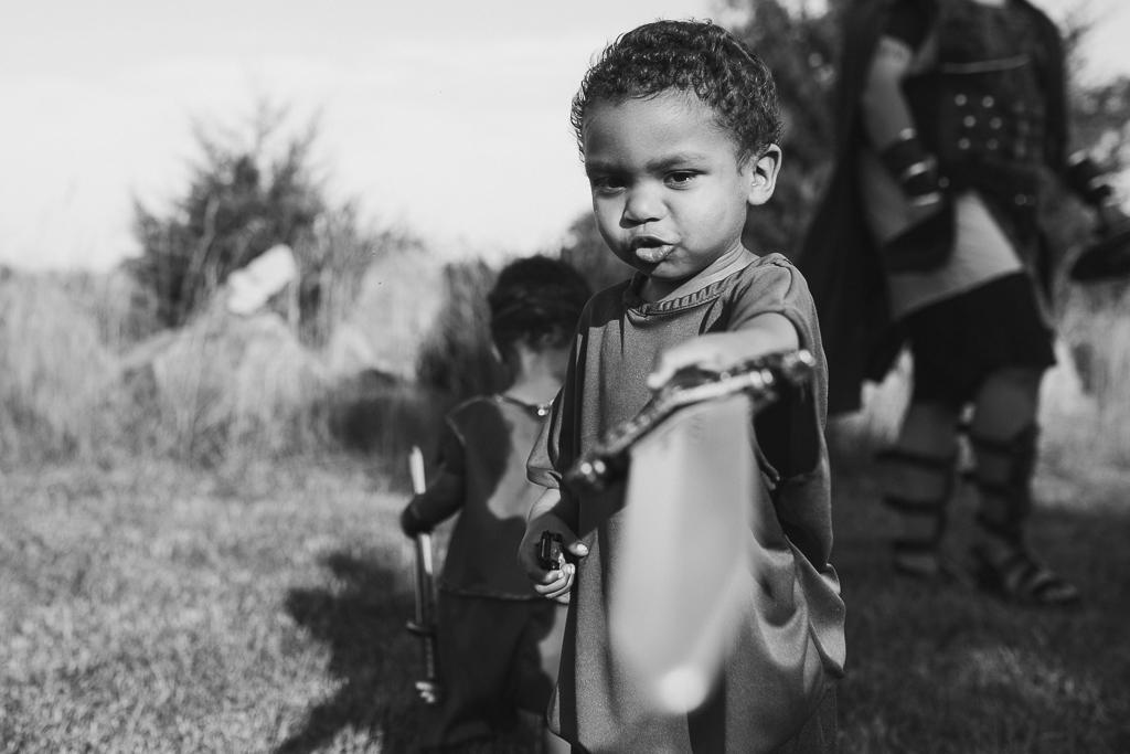 Black and white lifestyle childhood photography toddler boy sword warrior fighter Beaverdam Run Ashburn Virginia Loudoun County Marti Austin Photography TGHP The Gold Hope Project