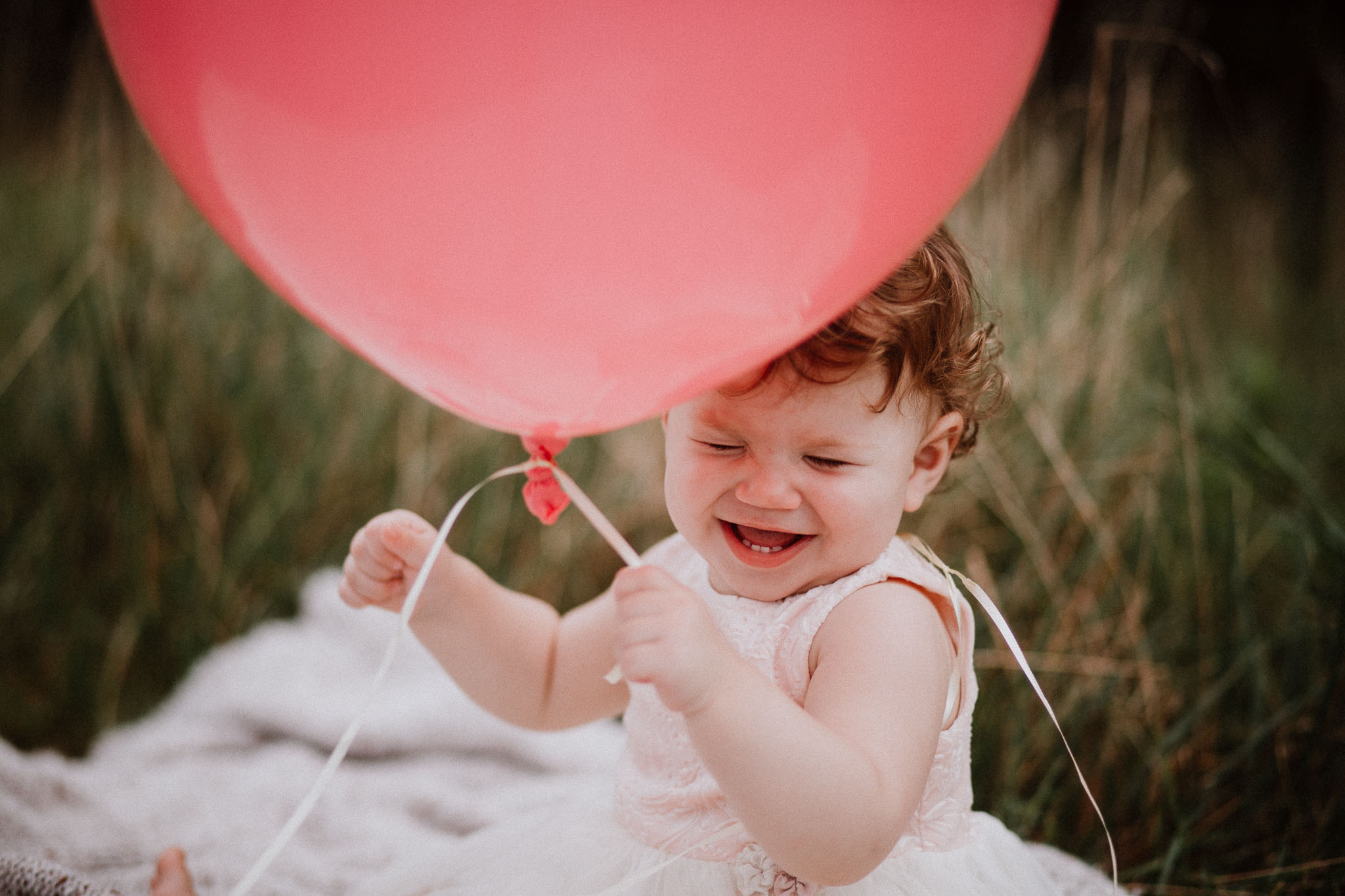 Toddler one year old girl pink balloon laughing Sterling Virginia Claude Moore Park Lifestyle Family Marti Austin Photography