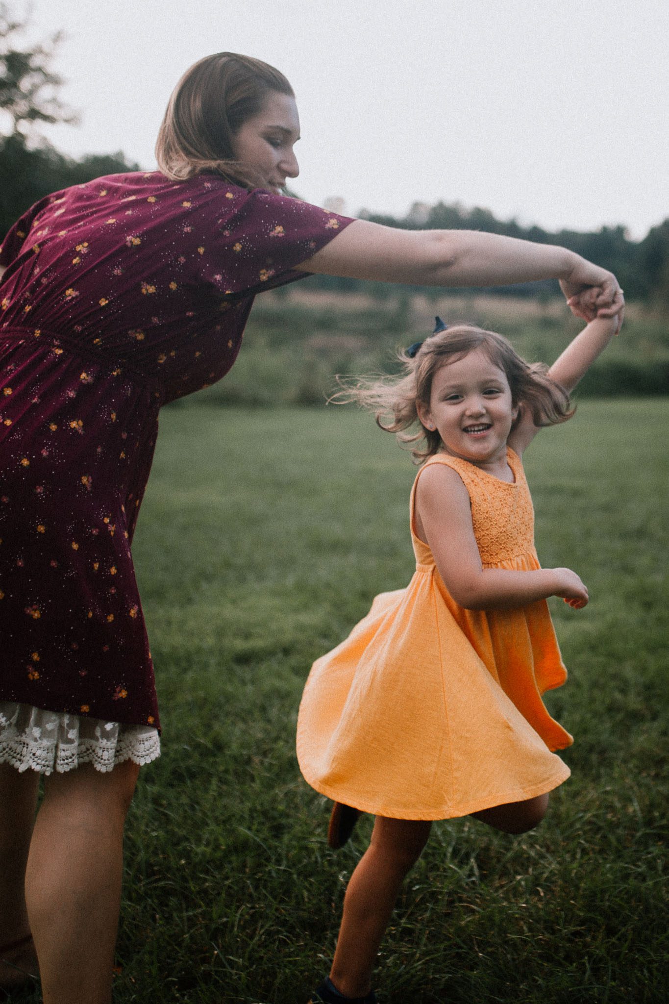 Mother daughter twirl spin Claude Moore Park Heritage Farm Museum Sterling Virginia Lifestyle Documentary Fall Family Marti Austin Photography