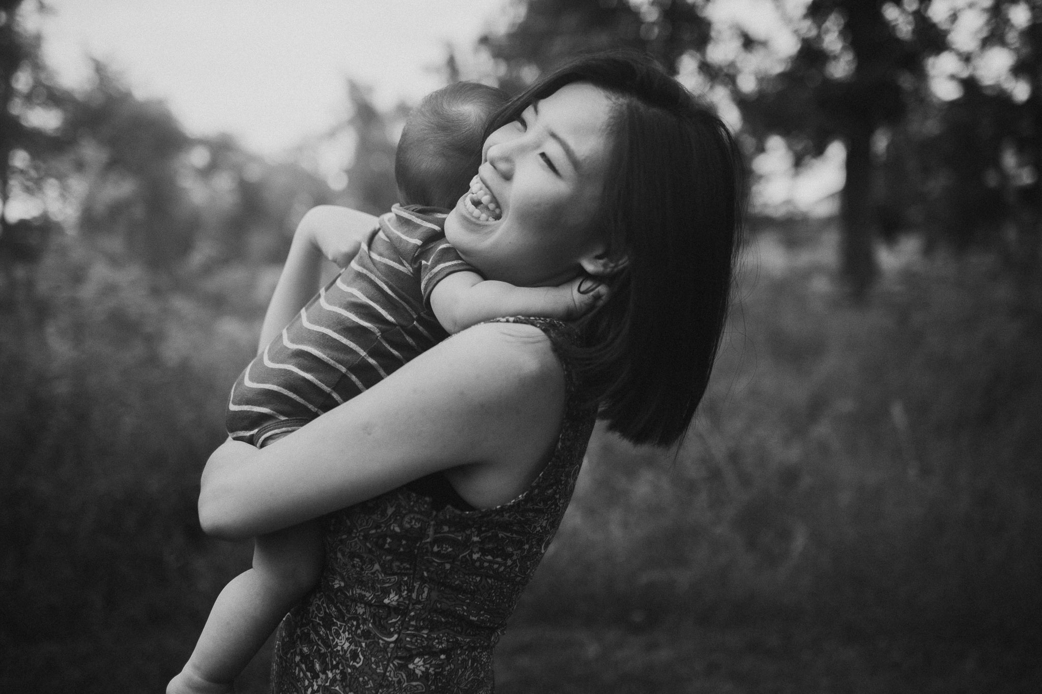 black and white mother son baby laugh hug lifestyle documentary family Barn at One Loudoun Ashburn Virginia Marti Austin Photography