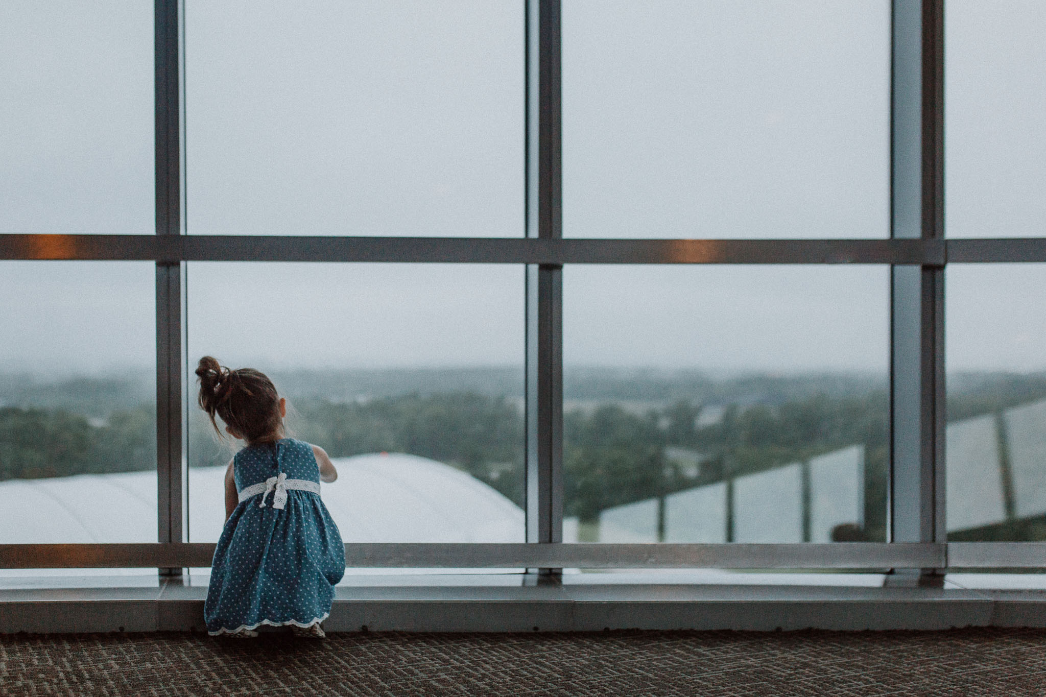 window Udvar Hazy Air and Space Museum Toddler Girl Ashburn Virginia Lifestyle Documentary Family Marti Austin Photography