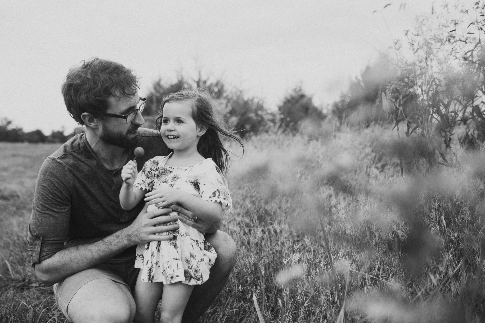black and white daddy daughter flower Toddler Girl Ashburn Virginia Lifestyle Documentary Family Marti Austin Photography