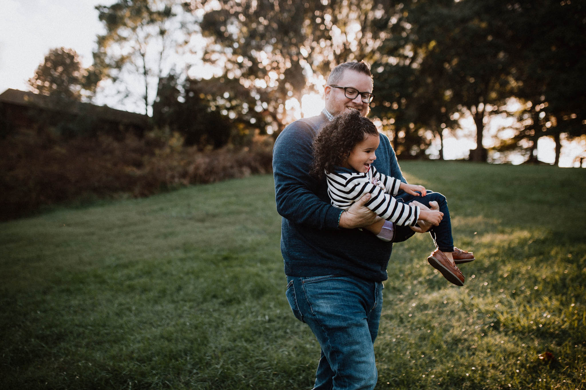 father daughter carry hold hug golden hour sunset  fall autumn Wolf Trap Vienna Virginia Lifestyle Documentary Family Marti Austin Photography