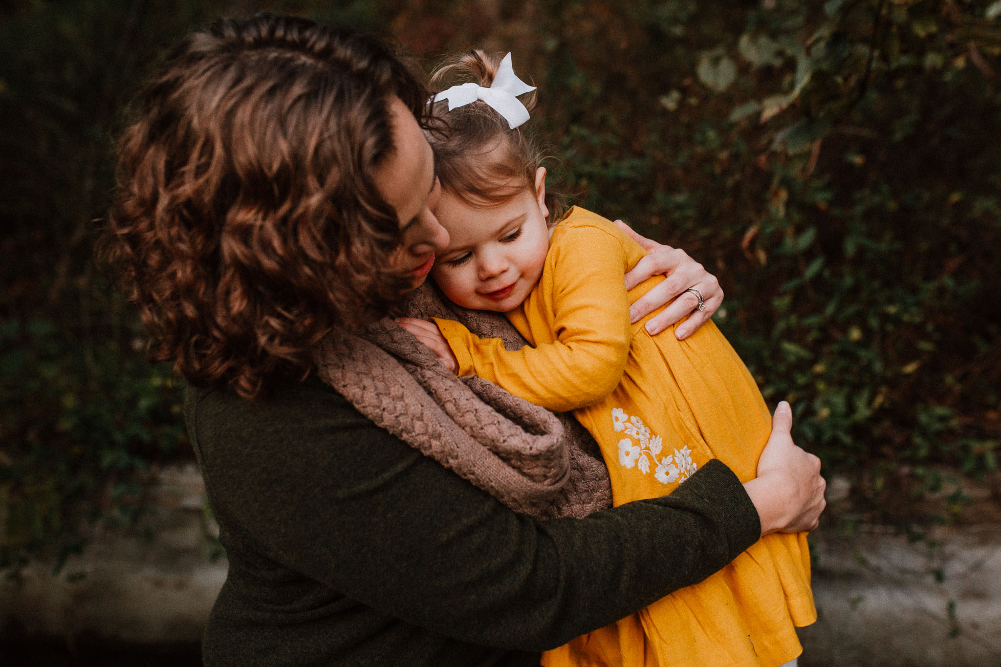 mother daughter hug cuddle fall sunset family lifestyle documentary Colvin Run Mill Great Falls Virginia Marti Austin Photography