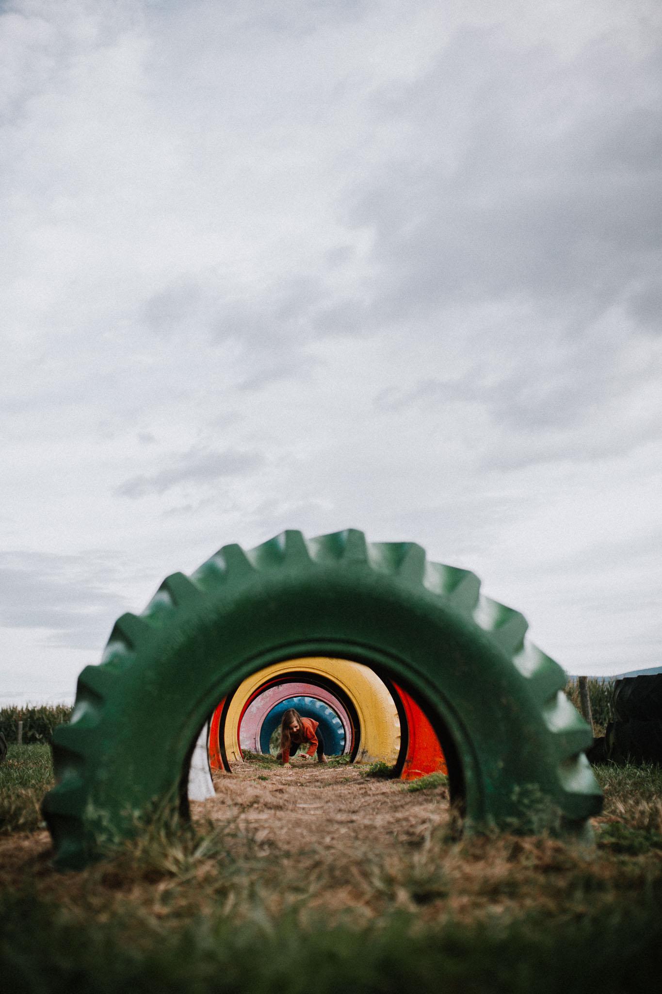 Farm toddler rainbow color tires Ashburn Loudoun Virginia Lifestyle Documentary Family Marti Austin Photography