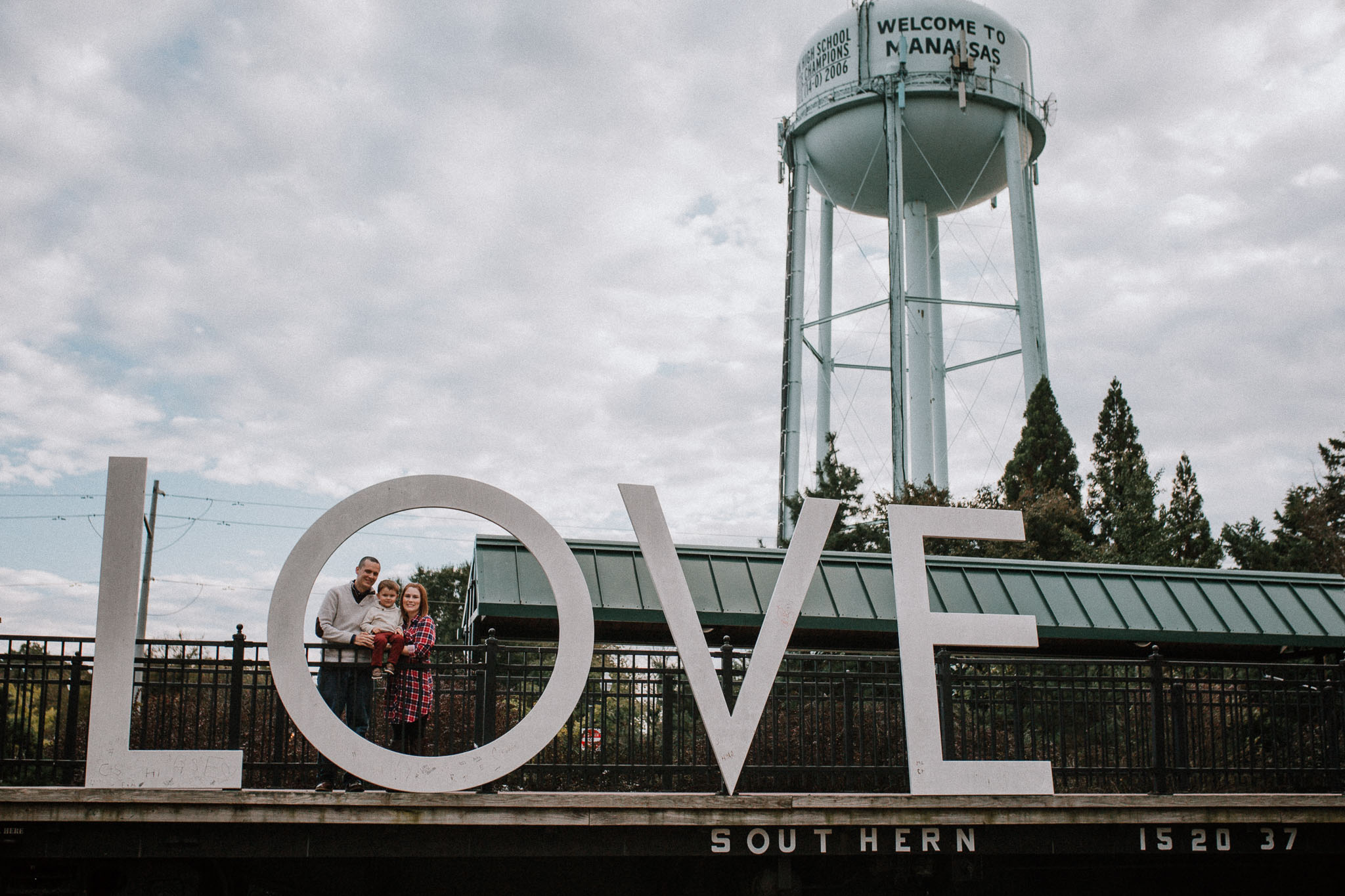 Love sign family of three fall autumn lifestyle documentary family Historic Old Town Manassas Virginia Marti Austin Photography